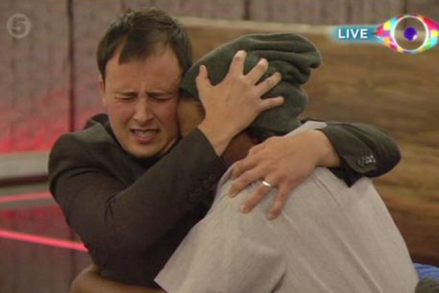 Big Brother winner Luke Anderson hugs a fellow contestant