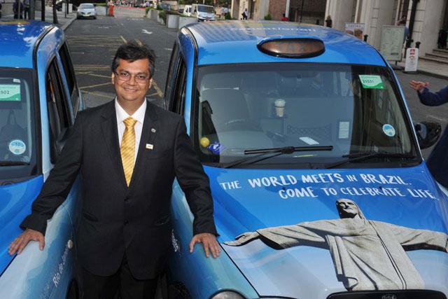 Flavio Dino: with branded London cabs