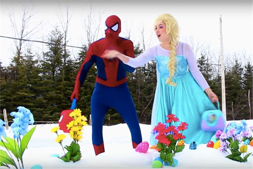 A still from 'Spiderman & Frozen Elsa vs Joker! w/ Pink Spidergirl Anna & Batman! Superhero Fun in Real Life,' a video by Webs & Tiaras that has more than 272 million views.