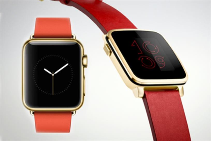 At Mobile World Conference, Pebble Time Steel (right) tried to steal Apple Watch's thunder.