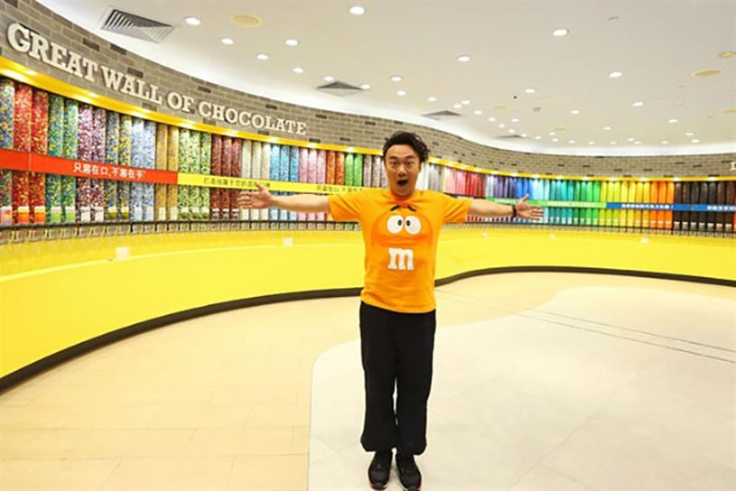 Canto-pop star Eason Chan at the M&M's World concept store in Shanghai.