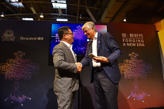 Agreement: SY Lau and Maurice Lévy.