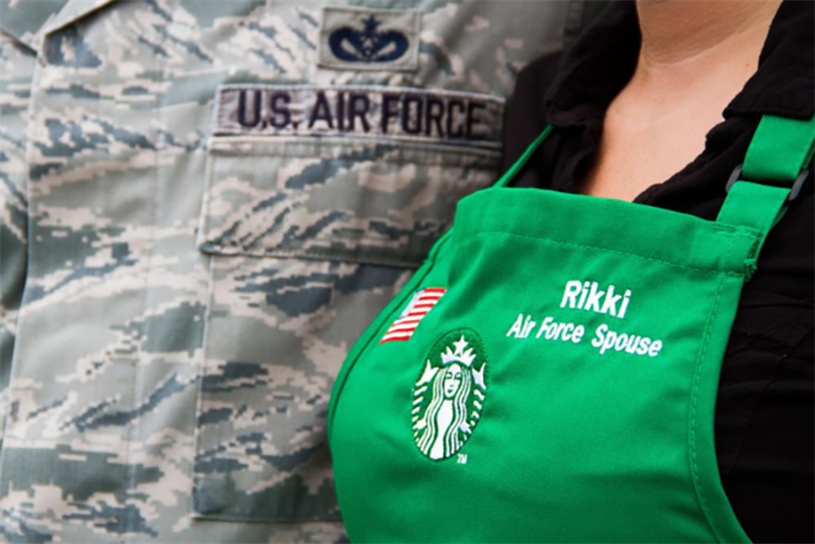 Embroidered flags adorn the aprons of Starbucks staffers who are veterans or military spouses.