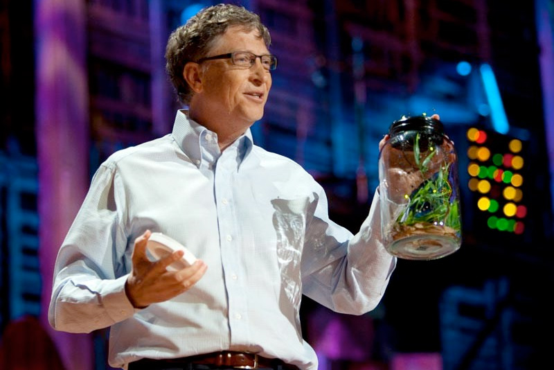 Bill Gates presenting a TED talk before releasing mosquitos into the audience.