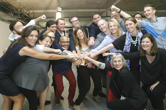 Wendy Clark (left), NA CEO for DDB, celebrates with her team after winning the McDonald's account.