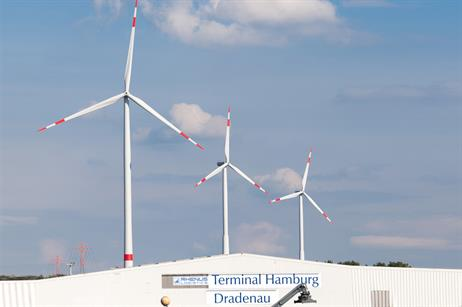 Eurogate's turbine in the foreground is taller than the other two at the port, and provide half of Eurogate's energy needs