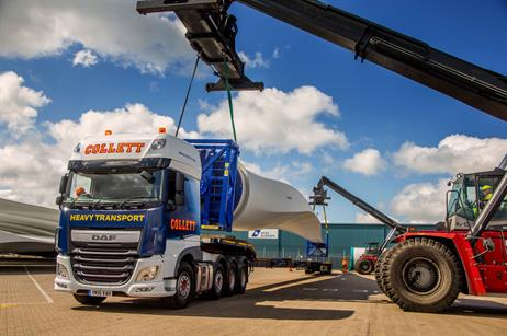 Two reach stackers load the 50-metre blades onto the trailer for deliver to Crook Hill project