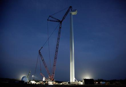 The nacelle being installed on top of the 140-metre tower