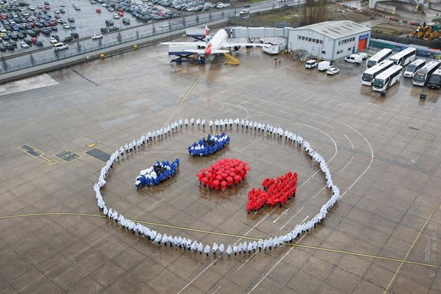 British Airways celebrated this year's Red Nose Day by inviting Strictly Come Dancing judge and former prima ballerina, Darcey Bussell to choreograph a recreation of the airline's famous 1989 'Face' advert, using BA volunteers. Travellers flying into Heathrow were able to catch a glimpse of the giant face complete with red nose, to illustrate this year's theme - 'Make Your Face Funny For Money'.