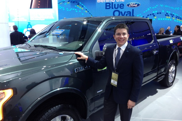 Alvaro Cabal, multicultural communications manager at Ford Motor Company, poses with the Ford F-150 -- the 2015 Truck of the Year.