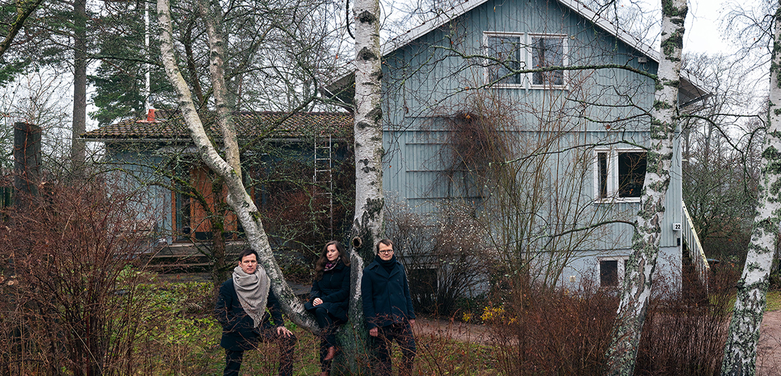 New Standards curatorial team Philip Tidwell (left), Laura Berger and Kristo Vesikansa in front of a Puutalo house in the Jollas district of Helsinki.