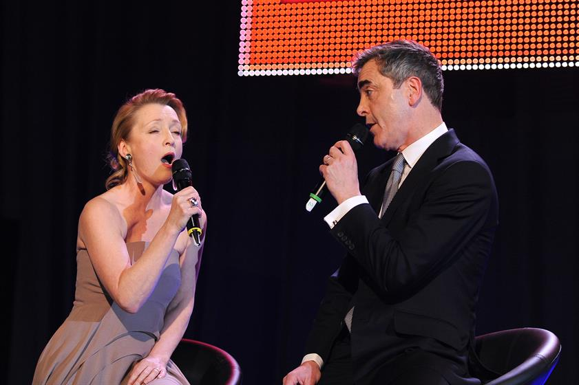 Presenter and actor James Nesbitt and actress Lesley Manville sing during the ceremony for the Moet British Independent Film Awards at Old Billingsgate Market on December 8, 2013 in London