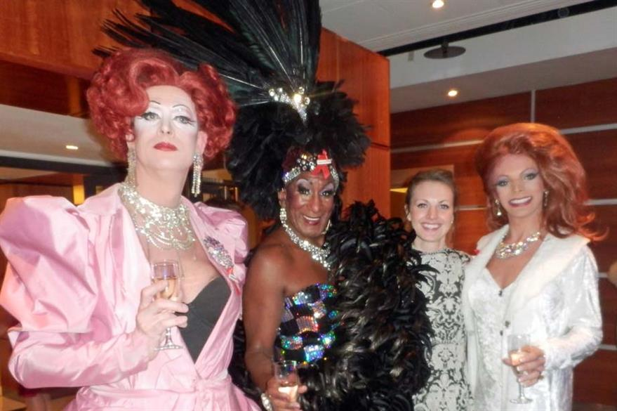 C&IT's news editor Alison Ledger poses with a few drag queens at the HBAA dinner