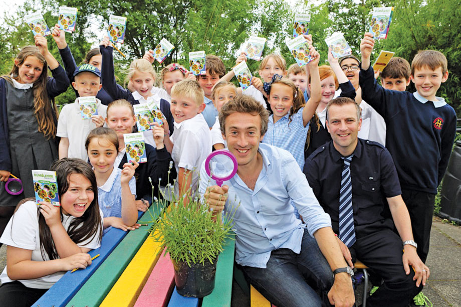 TV presenter and BSA ambassador Dallas Campbell (centre) leads the hunt for bumblebees