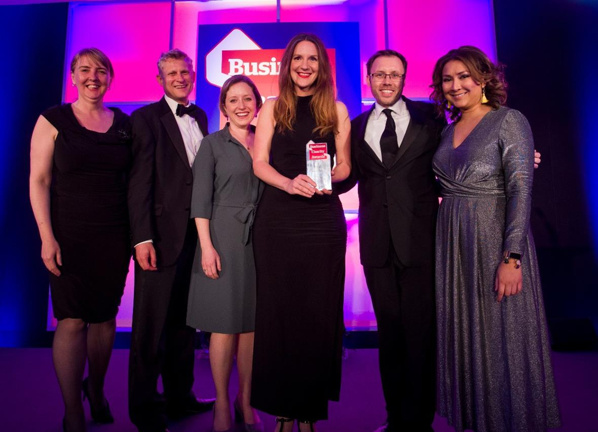 The AstraZeneca team accepts the award for its Plan International UK partnership