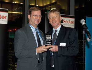 Children's Society chief executive Bob Reitemeier (left) receives the award from Stephen Pittam, chief executive of last year's winner, the Joseph Rowntree Charitable Trust