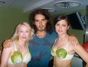 Vegetarian: Brand poses with animal rights supporters. Credit: PETA