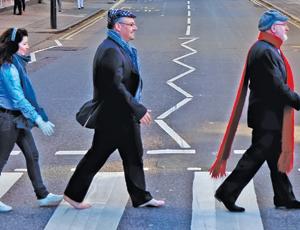 World Jewish Relief staff members walking across Abbey Road