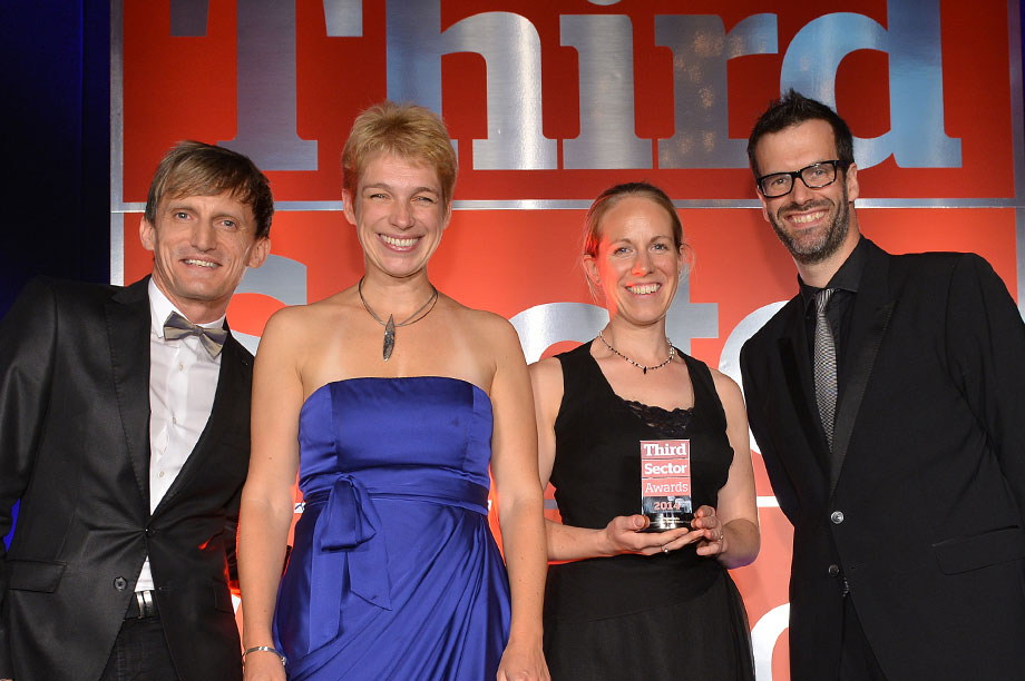 Staff from Cancer Research UK accept their award