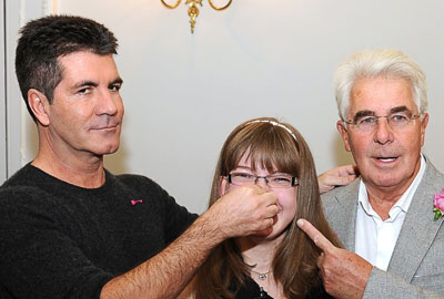 [l-r] Simon Cowell with Sian and Max Clifford