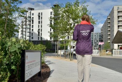 A Games Maker walking through the Olympic Village
