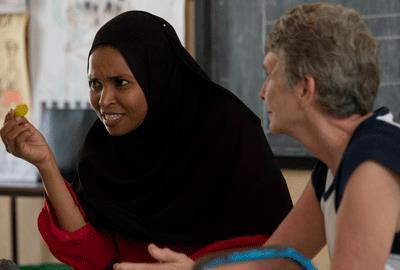 A VSO volunteer (right) working in a nursey school in Tanzania