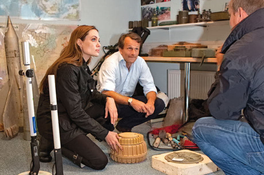 Guy Willoughby (centre), chief executive of the Halo Trust, with Angelina Jolie (left), a trustee