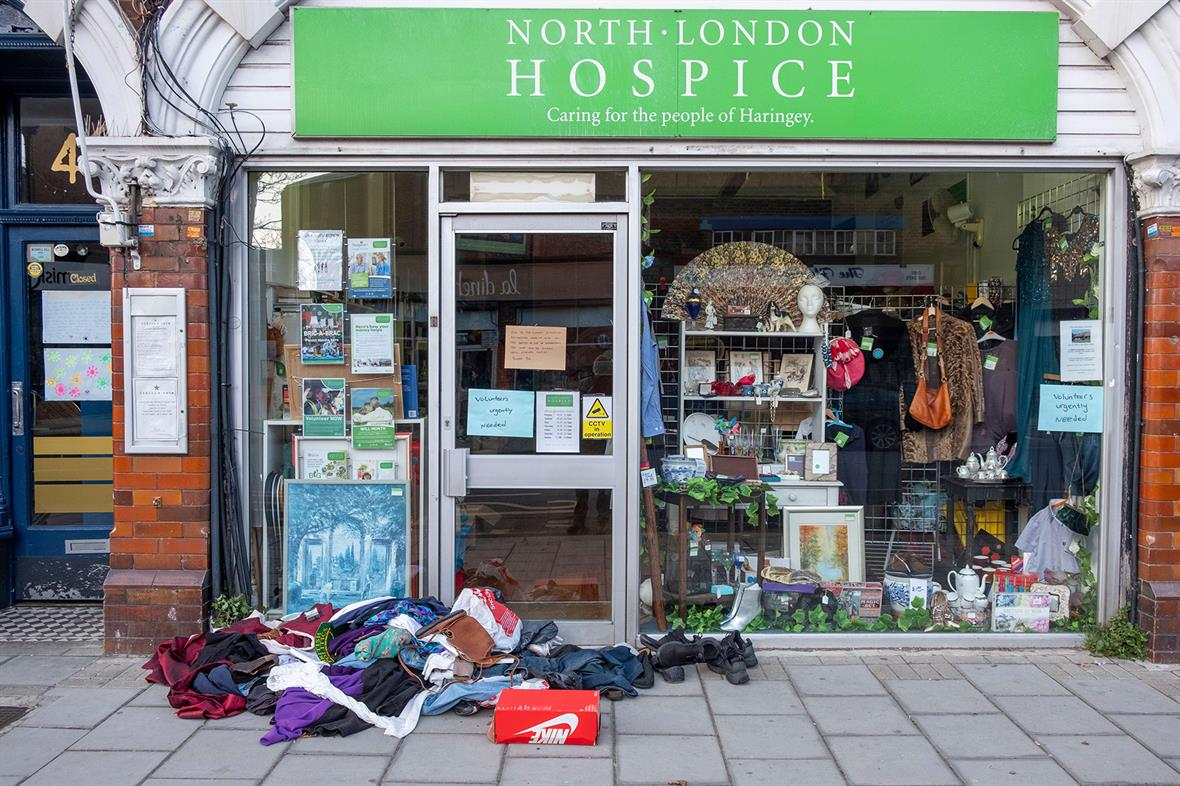 Covid-19 notices in charity shop window in Muswell Hill, London (Photograph: Mike Goldwater/Alamy)