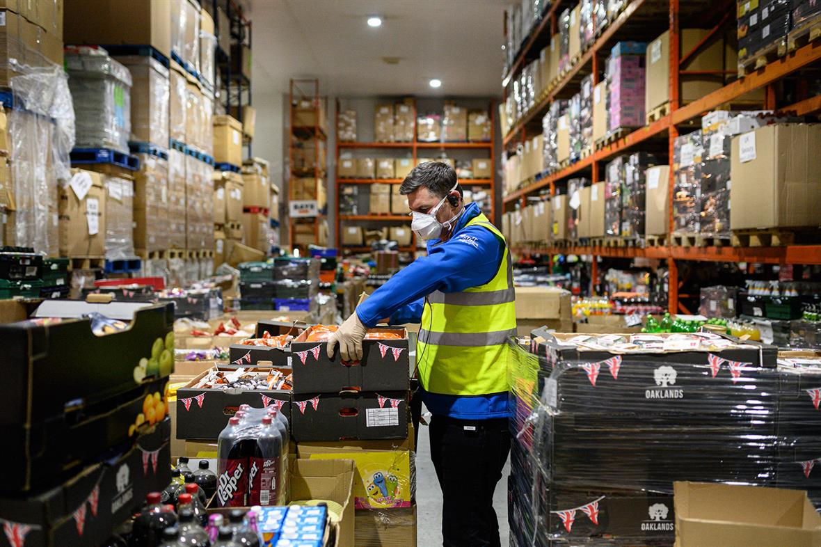 Richard Humphrey, senior coordinator at the charity His Church, prepares pallets of food to be distributed to charities near Market Rasen (Photograph Oli Scarff/AFP/Getty Images)