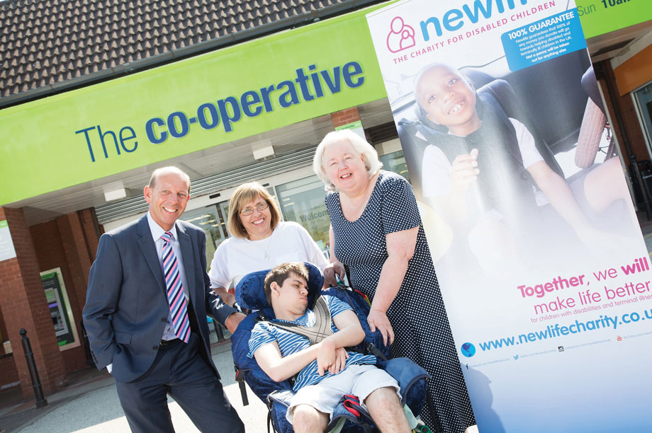 Central England Co-operative chief executive Martyn Cheatle (L), celebrates raising £1.5m for Newlife with charity chief executive Sheila Brown (R) and beneficiaries