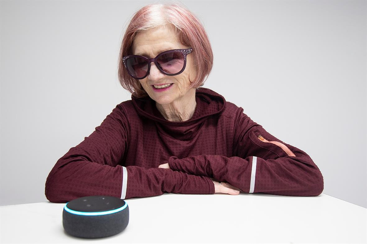 Dolly McLoughlin, who has sight-loss, with an Amazon device