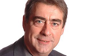 John Stoker, resigned as Compact Commissioner