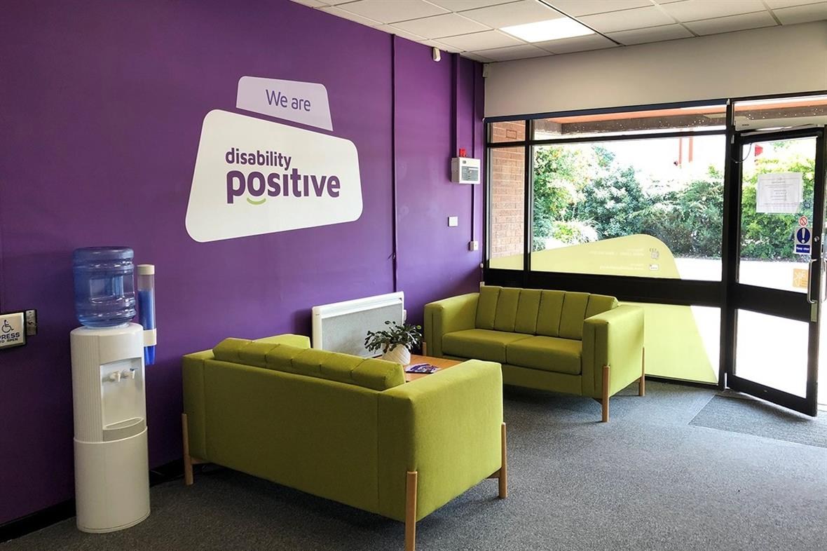 Disability Positive's offices with the new branding