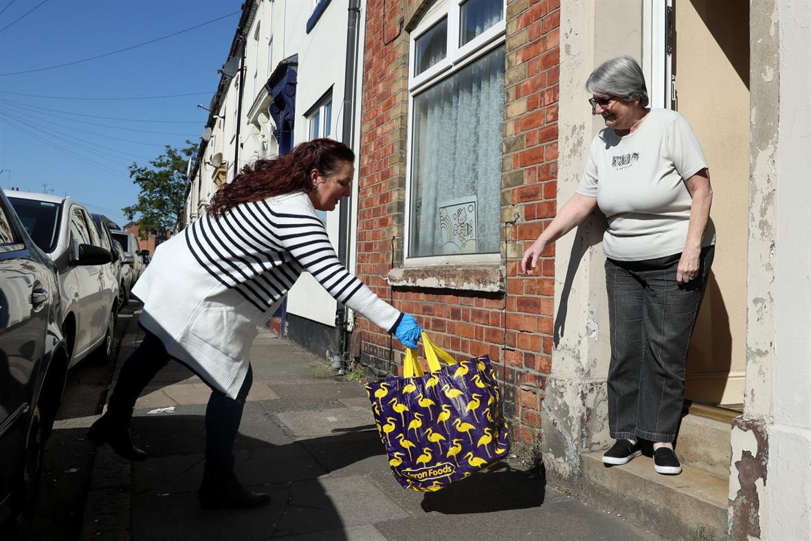 A food bank volunteer delivers a parcel in Northampton (Photograph: David Rogers/Getty Images)
