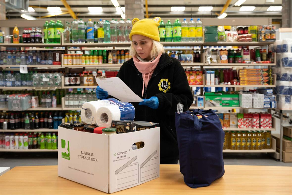 A volunteer helps provide an emergency food parcel in Cardiff (Photograph: Matthew Horwood/Getty Images)