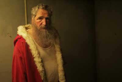 Jim Carter as Santa
