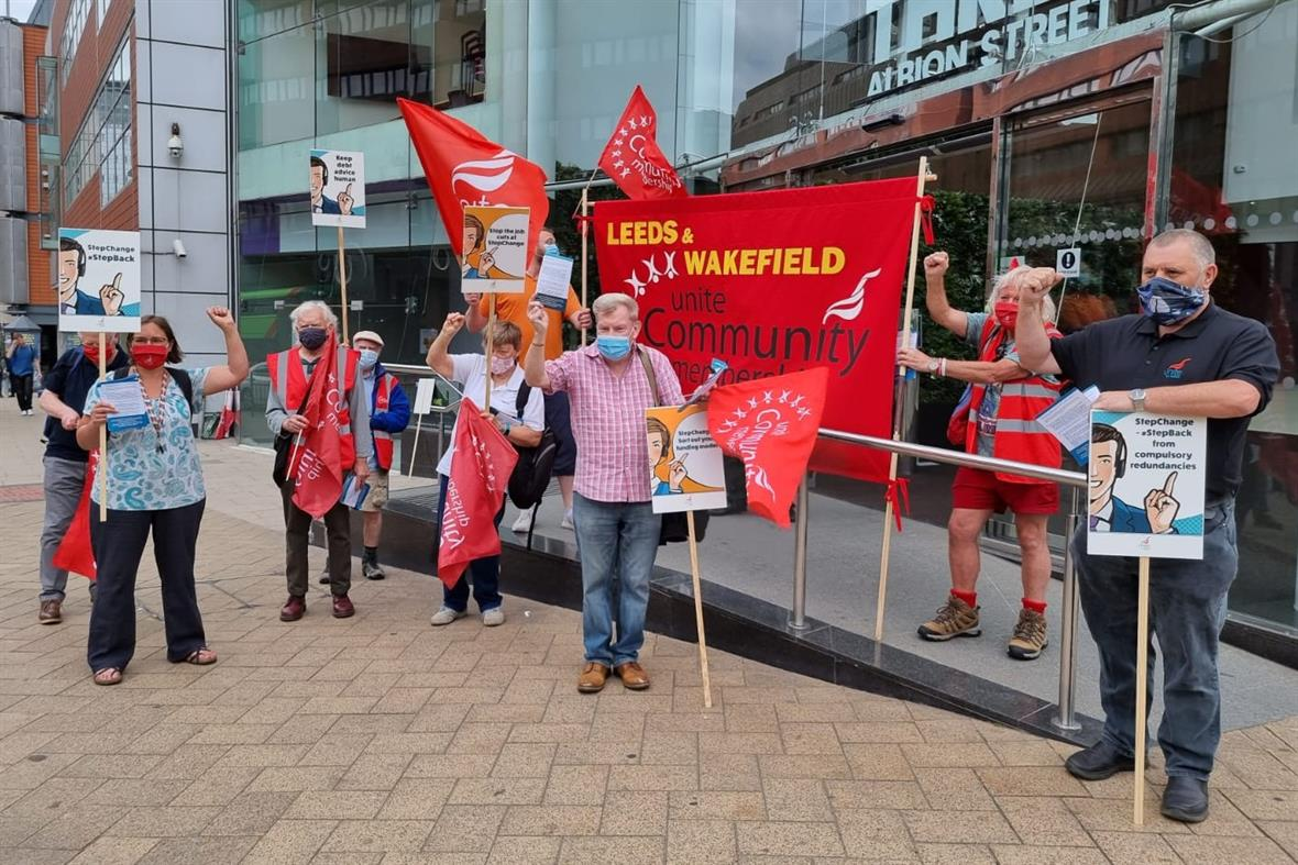 StepChange staff protest outside its office in Leeds