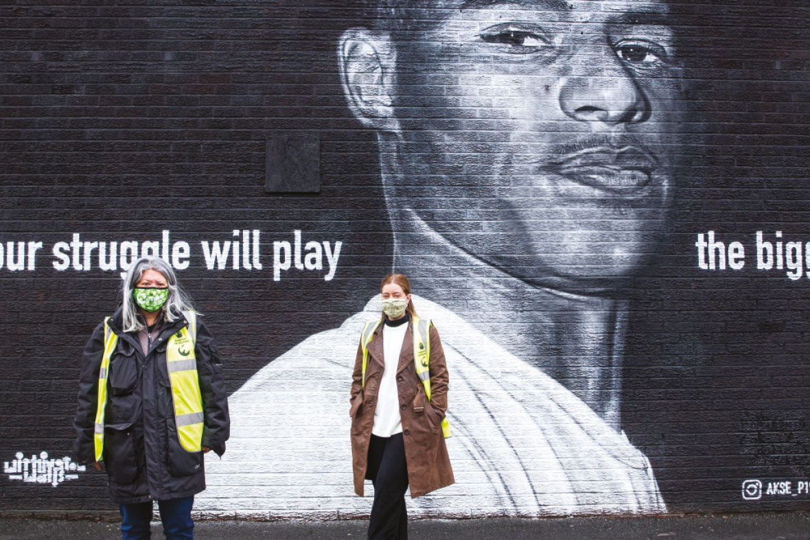 FareShare staff in front of a Marcus Rashford mural by street artist Akse. Photographed by Colin Stout