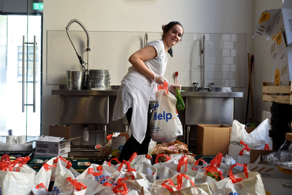 Volunteer from the Islington Covid-19 Mutual Aid group preparing food parcels (Photograph: Kate Green/Getty Images)