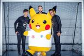 Pikachu with England footballers Michael Keane, Callum Wilson and Joe Gomez.