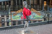 Amy Winehouse and Sherlock Holmes statues wrapped in red coats for Wrap Up London