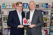 Keith Weed (left) receives the Global Marketer of the Year award from WFA's David Wheldon