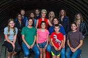 Artist Maggie Rose with female farmers and their families