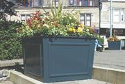 Plantscape clients order large planters to double as a traffic calming solution