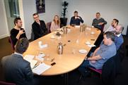 Participants debating at the RAB Roundtable