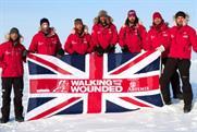 Simon Daglish (centre): raising the flag for the troops