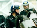 Riot police in action