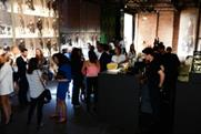 Guests sipped beer and cocktails as they browsed the new collection