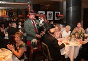 Guests enjoy the piper during Burns Night at Marco's
