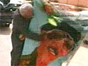Baghdad: image sof Saddam Hussein are being defaced